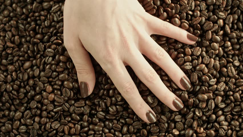 Conceptual clip of coffee beans, slow motion