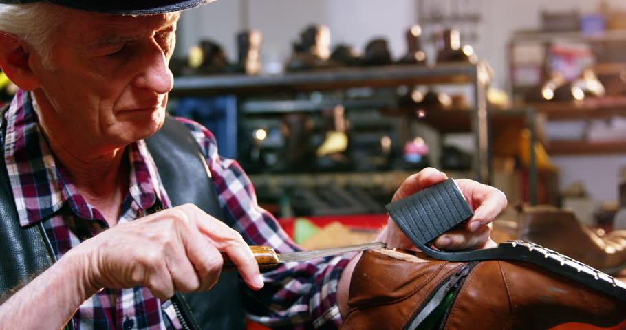 Shoemaker repairing a shoe in workshop 4k   Shutterstock HD Video #20306905
