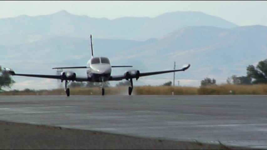 Twin Engine Plane Taking Off