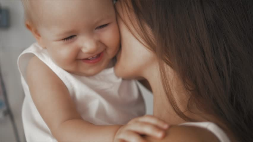 Mother and Baby. Happy Family. Mom With her Child smiling and laughing at home. | Shutterstock HD Video #20356015