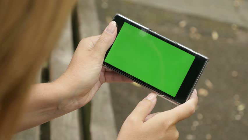 Enjoying in the park blond female holding smart phone with greenscreen display 4K 2160p 30fps UHD video - Green screen chroma key tablet in woman hands outdoor 3840X2160 UltraHD footage | Shutterstock HD Video #20360185