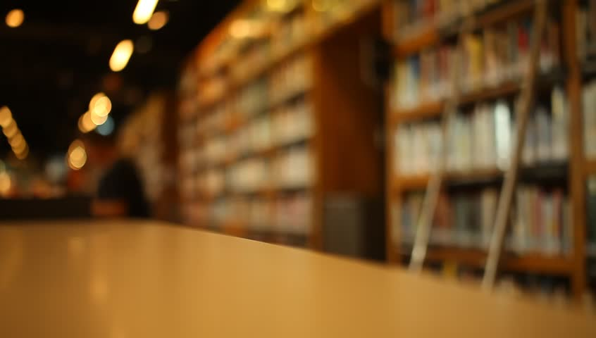 on the table at library blurred background stock footage