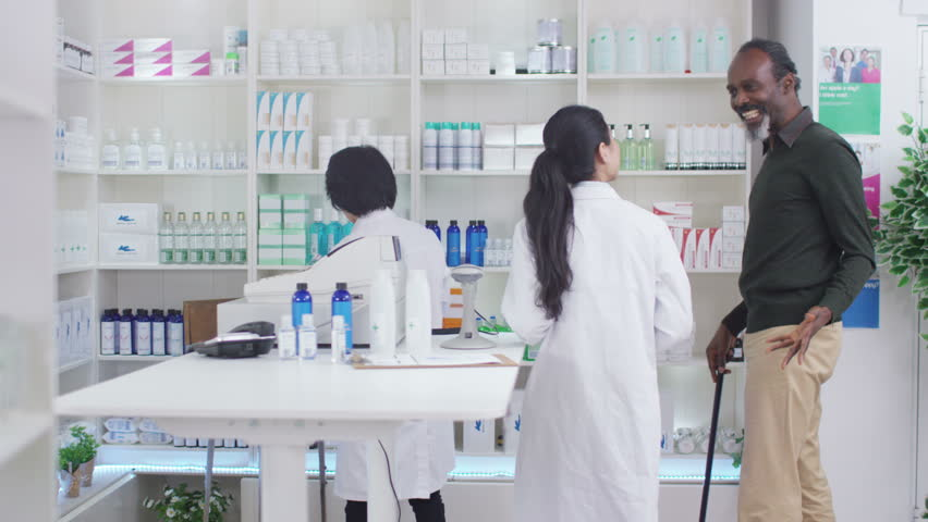4K Friendly pharmacy worker advising mature man which medication to take. Shot on RED Epic. | Shutterstock HD Video #20382715