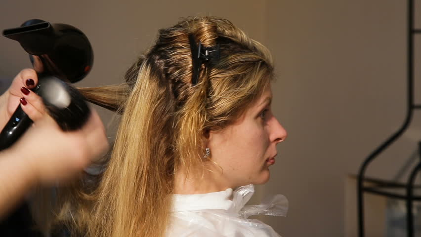 Beautiful Woman At The Hairdresser Drying Her Hair Long Brown With Dryer And Round Brush Salon