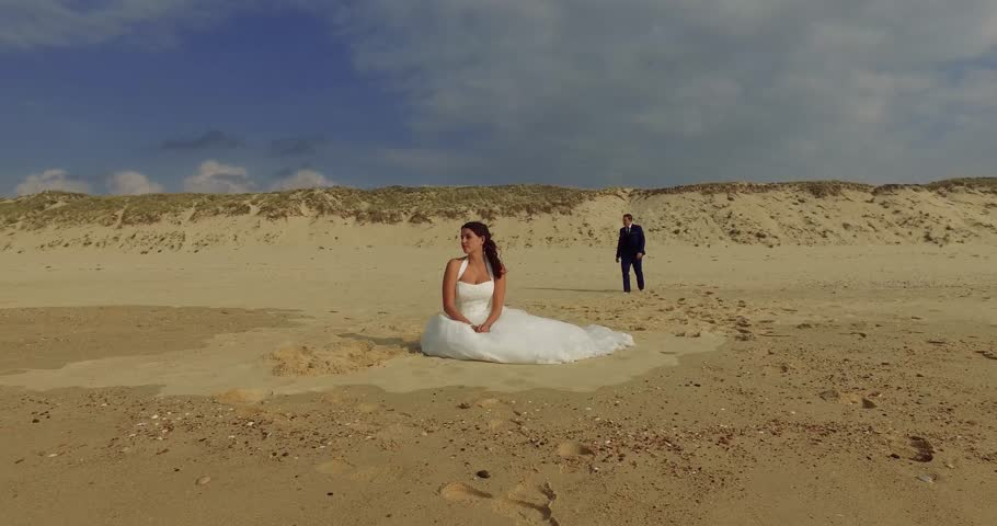Man and woman sitting on the beach   Shutterstock HD Video #20448145