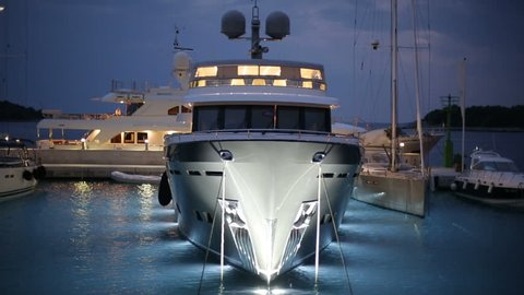 ISLAND OF SOLTA, CROATIA - SEPTEMBER 9, 2016: Large white expensive yacht in marina waiting for owner in the night time