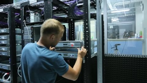 a man working in a server room.
