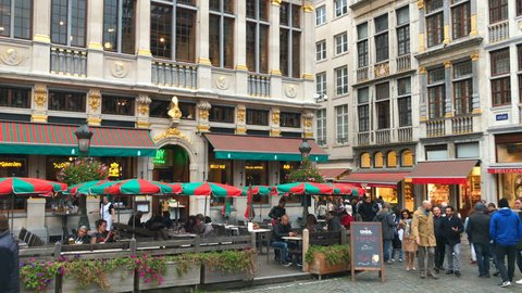 Brussels Belgium 7 OCT 2016: Tourists crowd walking at Grand Place (Grote Markt) - main central square of Brussels (Bruxelles) city, Belgium, EU. People visit restaurants cafe in Brussels, Grand Place