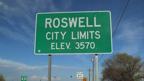day pan silver van left right away Roswell City Limits road sign