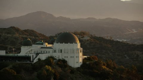 Aerial Griffith Observatory sunrise Los Angeles California Hollywood Hills sun flare USA Telescope building Skyline travel tourism Viewpoint Museum Landmark