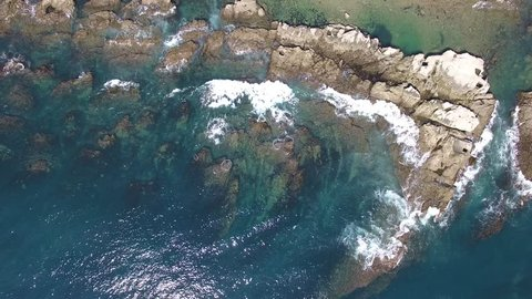 Aerial view of wave on the rocky coast
