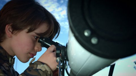 4k Technology and Astrology Child with Telescope Exploring the Sky