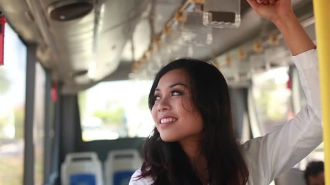 beautiful young woman traveling by bus