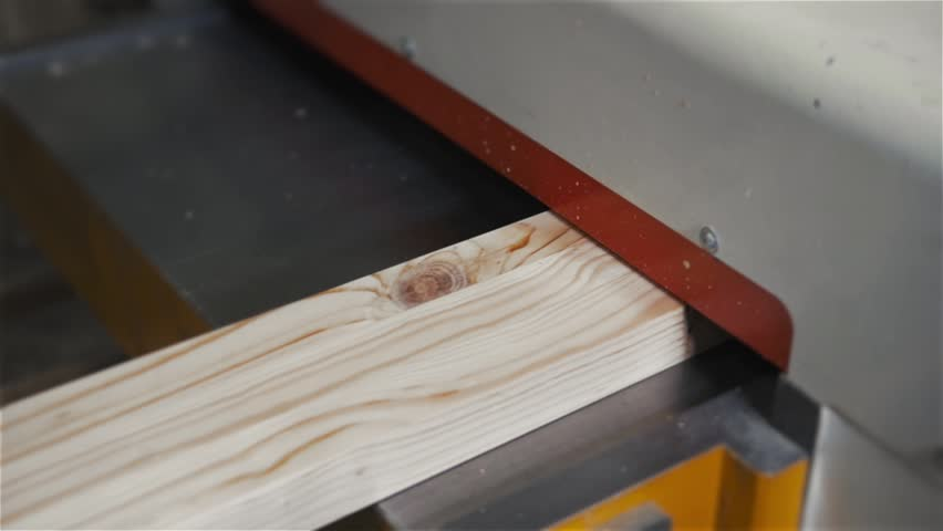 Modern Furniture Video man using a table saw to cut wood, grinding on modern furniture