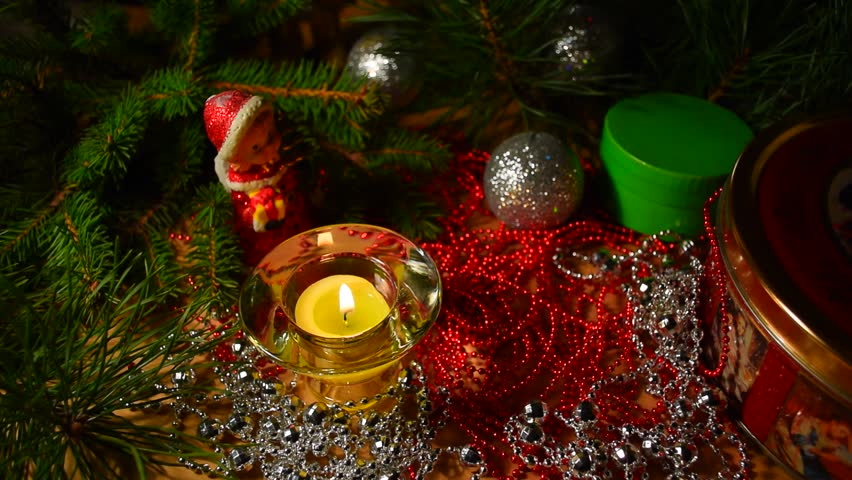 New year celebration background. Christmas, advent, new years collage with tree branches, candle, gift box, christmas balls and decoration. Candle light closeup at background of christmas decoration. #20626216