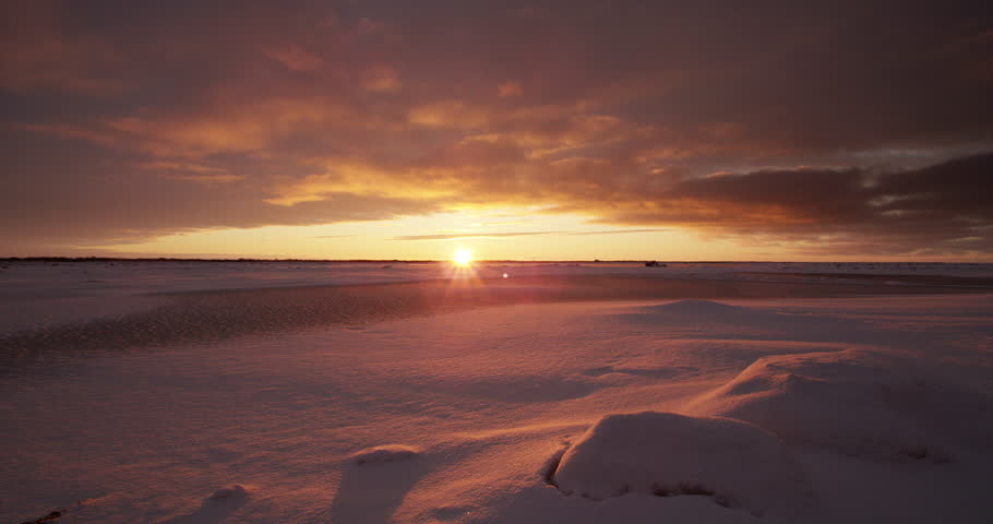 Time lapse - clouds rushing over tundra at sunset with snow   Shutterstock HD Video #20650885
