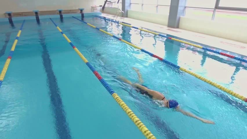 Professional woman swimmer training in swimming pool | Shutterstock HD Video #20675035