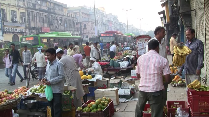 DELHI - NOV 13: Vegetable street vendors with their mobile stands on November 13, 2011 in Delhi, India. India ranks second worldwide in farm output. Agriculture employs 52.1% of the total workforce.