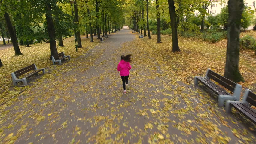 A young woman running / jogging in the city park. Aerial View    Shutterstock HD Video #20739265