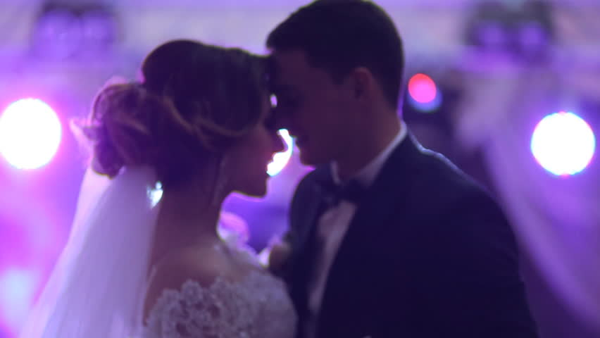 Newlywed couple hugging and dancing on their wedding day