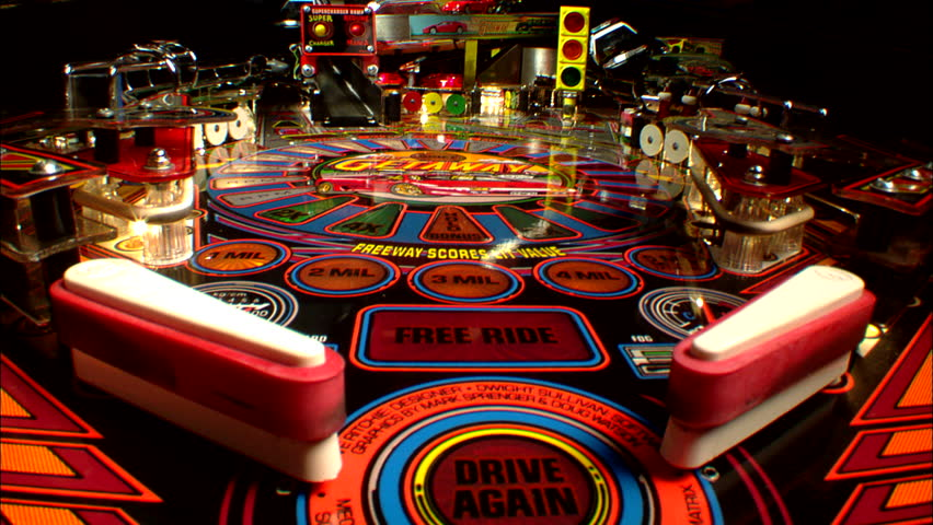 INTERIO right INSERT Static Tight CU Low POV across playfield car auto themed pinball machine, from behind flippers Game progress arcade, games `