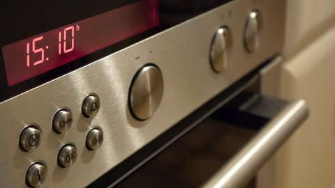 Timer setting on the oven and hob