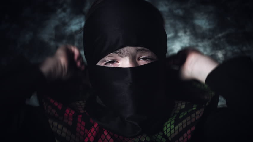 4k Anime and Halloween Shot of a Child in Ninja Costume Taking Hood off | Shutterstock HD Video #20820835