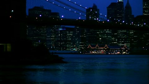night Brooklyn Bridge with New York skyline South street Seaport then pans right reveal World Trade Center view from Brooklyn