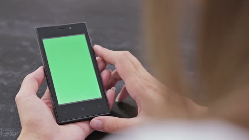 Woman using smartphone with green screen. Close up shot of woman's hands with mobile. Various hand gestures - scrolling and touching