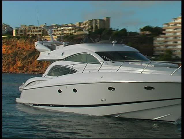 Motoryacht approaching harbor, clip 1