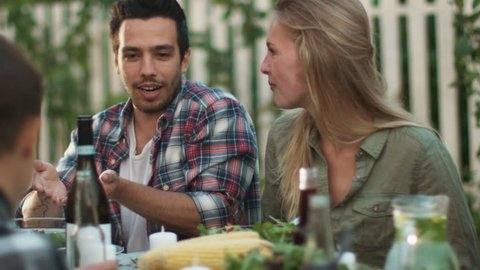 Smiling Hispanic Ethnicity Man Communicating with a Young Woman at Outdoor Family Dinner. Shot on RED Cinema Camera in 4K (UHD).