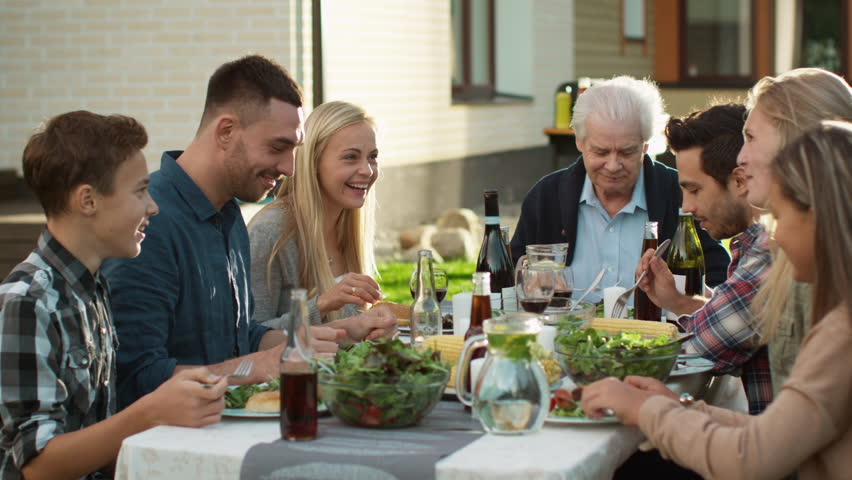 Group of Mixed Race People Having fun, Communicating and Eating at Outdoor Family Dinner. Shot on RED Cinema Camera in 4K (UHD). | Shutterstock HD Video #20914285