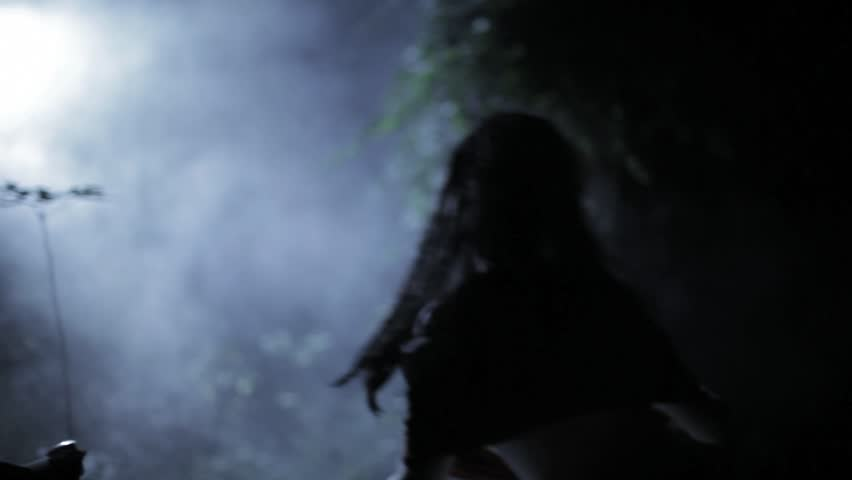 VIRGINIA - SUMMER 2016 - Reenactment, Recreation -- Ghostly, undead woman in smoky haunted garden outside.  Paranormal, poltergeist.  Mystery woman with pale pallor, 19th century clothing, flowing. #20937355