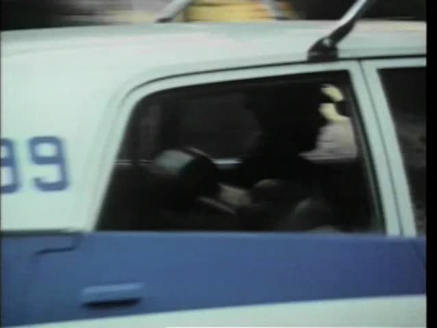 1970s police car driving through New York City streets