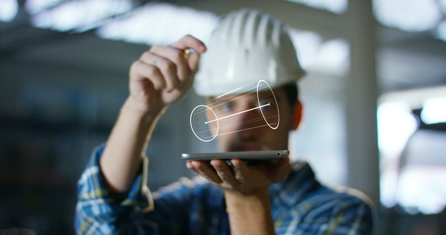 A worker uses a future technology platform to verify the design in holography and augmented virtual reality. Concept: future technology, multimedia technology, futuristic engineering. | Shutterstock Video #20989348