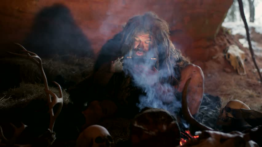Prehistoric caveman with tablet PC in cave | Shutterstock HD Video #21021595