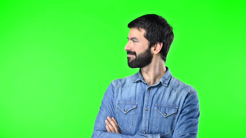 Handsome man looking lateral on green screen chroma key | Shutterstock HD Video #21023815