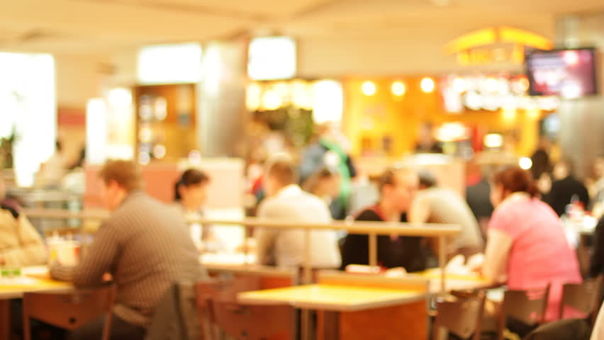 Shopping mall food court with people eating