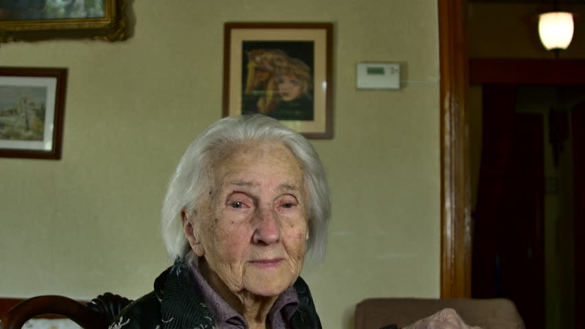 A Hundred Years Old Woman Looking At Her Birthday Cake, Centenarian
