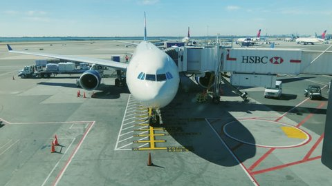 New York, USA - OKTOBER 12, 2016: Big airliner in the airport terminal is ready to receive passengers. JFK Airport in New York City