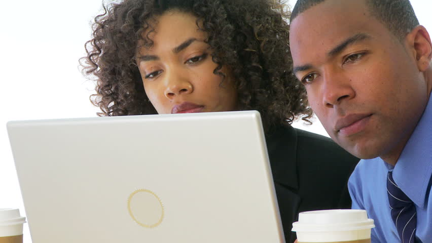 Close up of two businesspeople looking at computer screen
