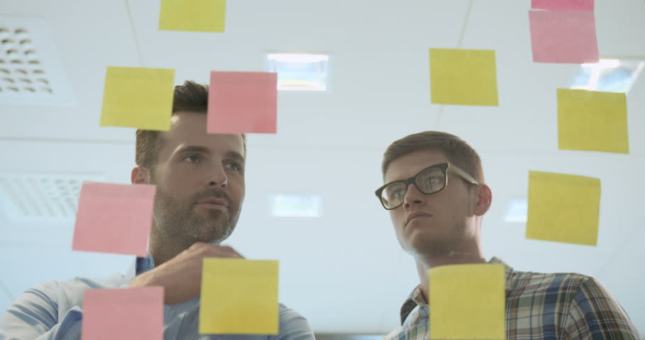 Creative casual people braminstorming ideas at the office | Shutterstock HD Video #21045475