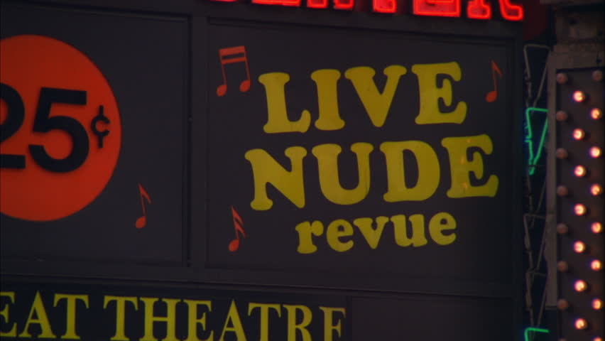 day Neon XXX Movies Live Nude Revue strip club sign, adult theater