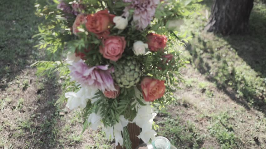 Outdoor wedding ceremony decoration before reception. Beautiful flower composition in sunlight. #21074035