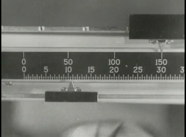 Close-up of person on scale during weigh-in