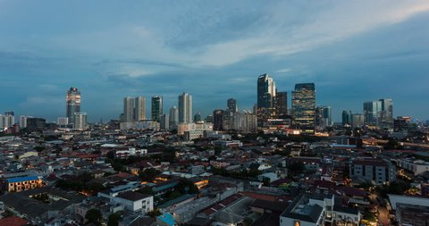 Time lapse of sunset over Jakarta skyline, Indonesia capital city as a day to night video over the Kuningan business district. Jakarta is South East Asia largest city.