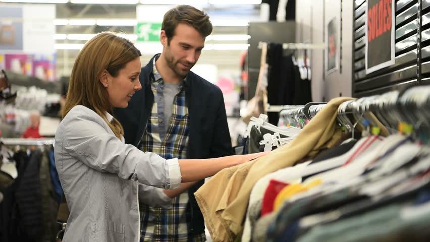 Couple shopping together in clothing store  | Shutterstock HD Video #21083167