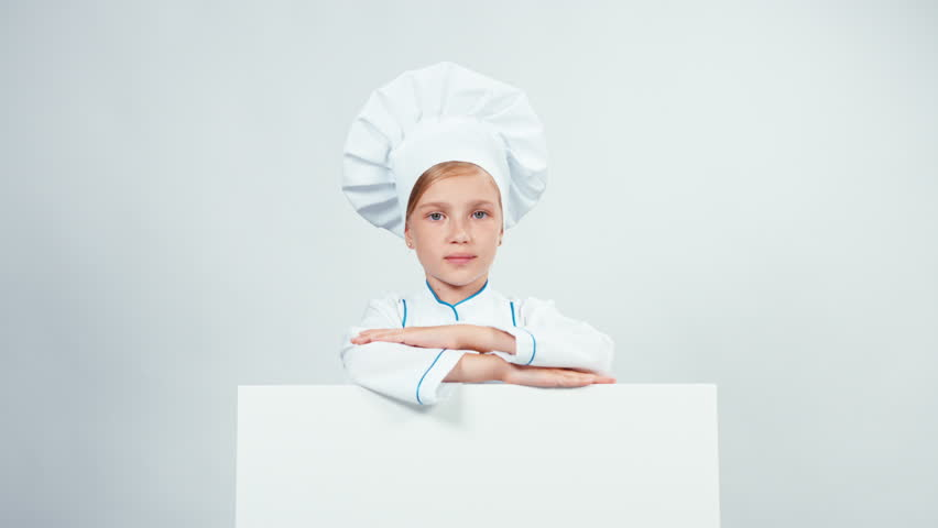 Portrait little chef cook in cap with white board isolated on white smiling at camera. Thumb up. Ok | Shutterstock HD Video #21083959