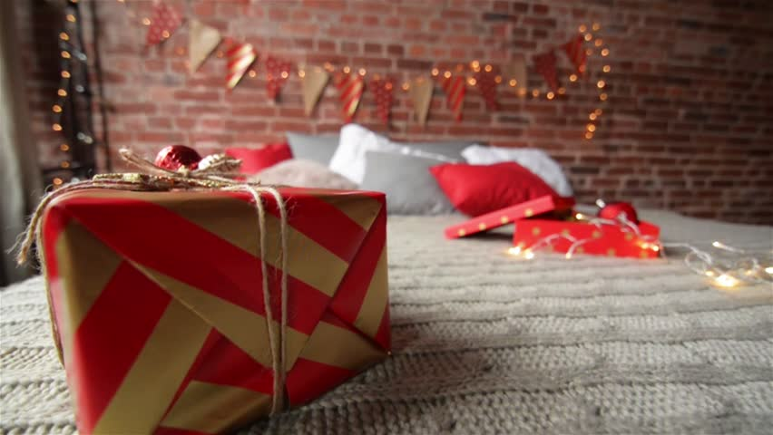 Wrapped Presents on a Bed in Hotel Room in the Morning, Christmas Gifts in the Bedroom, Merry Christmas | Shutterstock HD Video #21092875