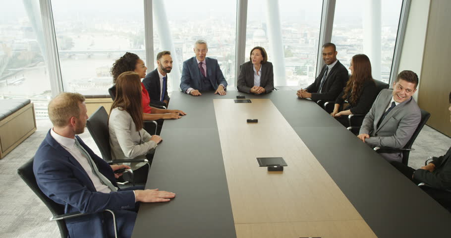 4k, Large group of multi ethnic business people during a corporate boardroom meeting. Slow motion.   Shutterstock HD Video #21099505